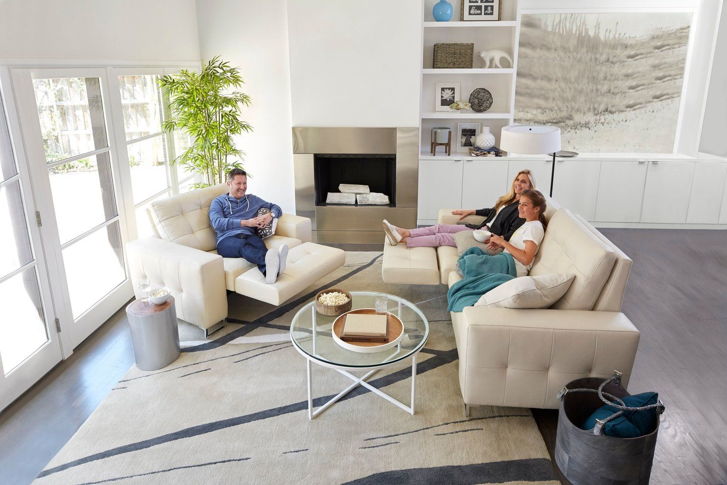 <img src=&quot;brightlivingroom.jpg&quot; alt=&quot;three people sit in a bright living room with neutral-colored furniture.&quot;>