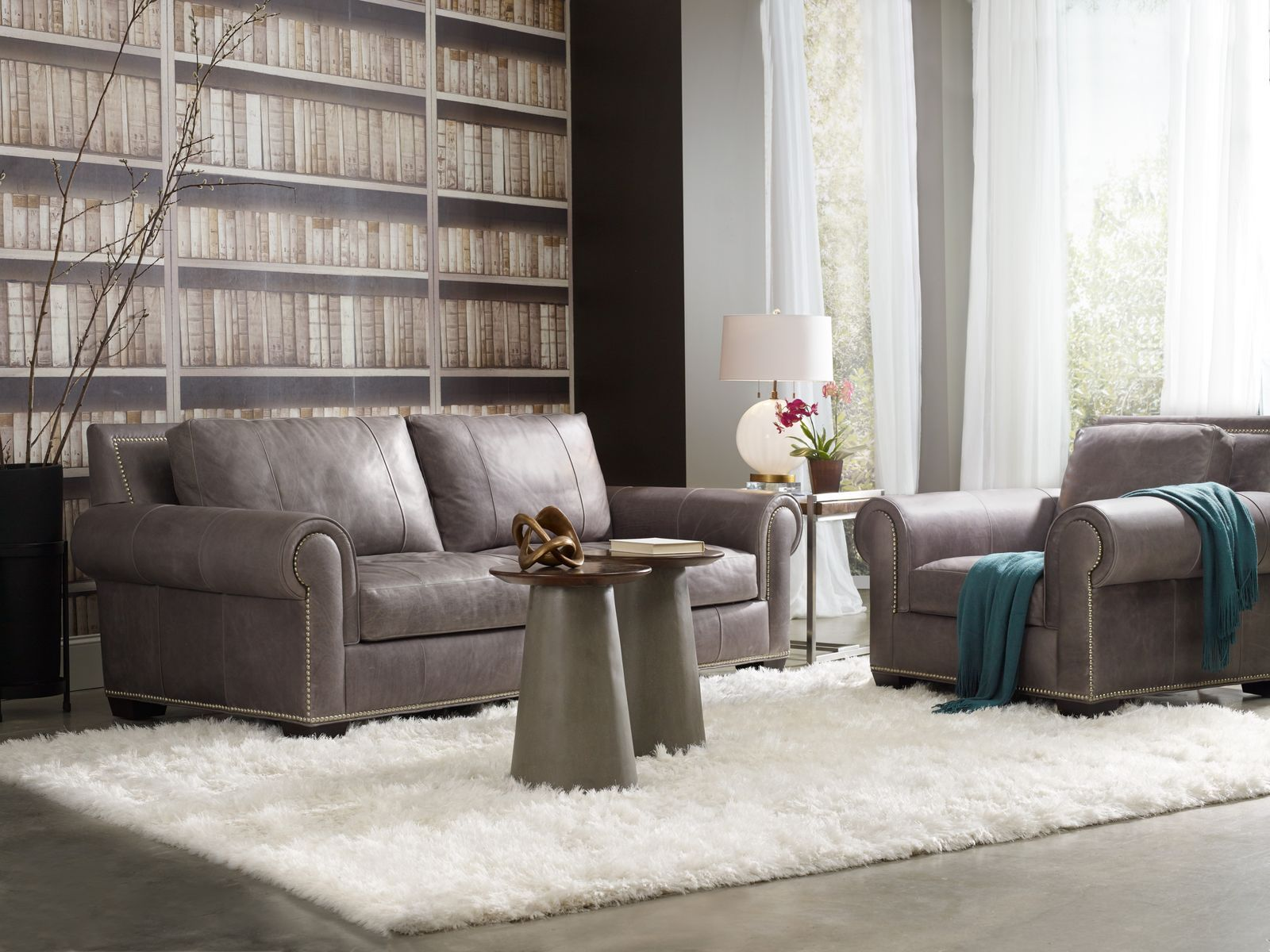 <img src=&quot;livingroom.jpg&quot; alt=&quot;a leather couch in a living room with wide windows.&quot;>