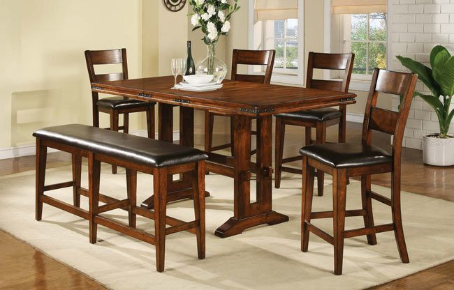 <img src=&quot;woodendiningset.jpg&quot; alt=&quot;dining set made of wood and upholstered pieces.&quot;>