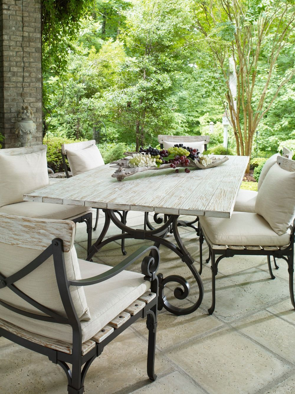 <img src=&quot;patio.jpg&quot; alt=&quot;covered patio with light-colored, wood and metal upholstered seats, and a table.&quot;>