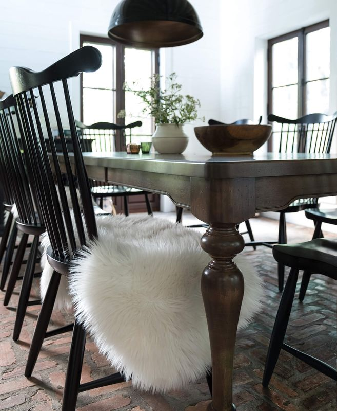 <img src=&quot;dining table with chairs.jpg&quot; alt=&quot;wooden dining table with black, spindle back chairs.&quot;>