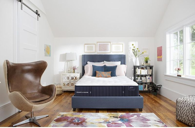 <img src=&quot;bedroom.jpg&quot; alt=&quot;bedroom with a firm mattress, leather club chair, side tables, ottoman, and other design elements.&quot;>