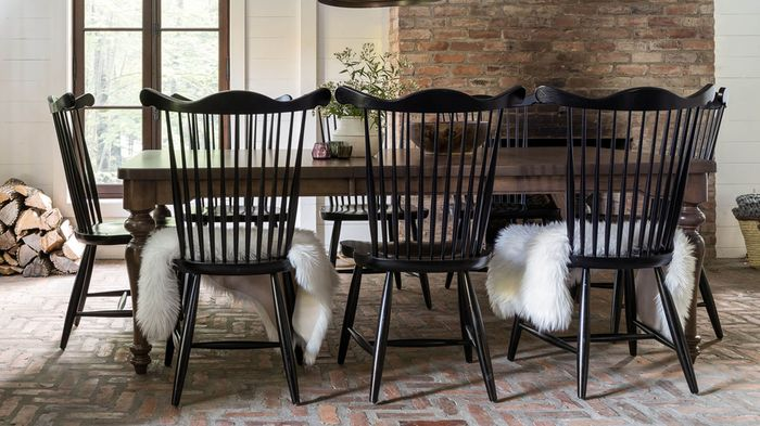 <img src=&quot;dining room&quot; alt=&quot;dining room designed with a wooden, rectangular table and black, spindle back chairs.&quot;>