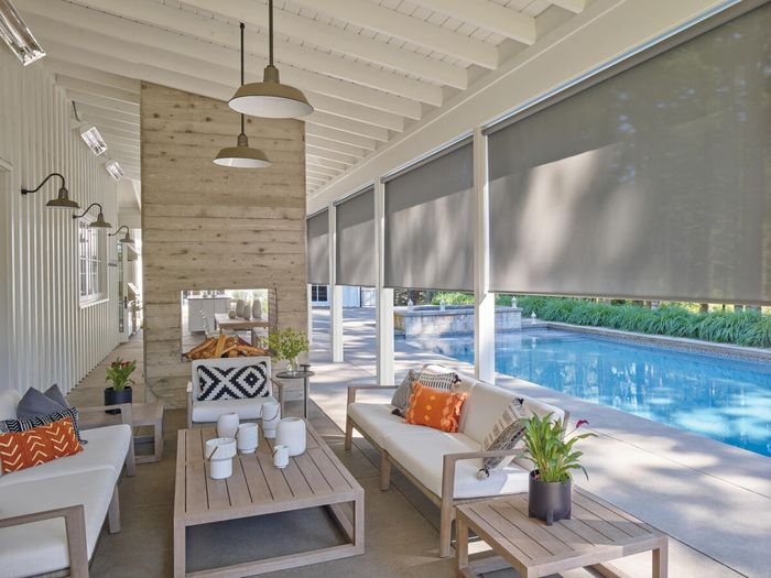 <img src=&quot;sunroom alt=&quot;sunroom with gray-colored window shades, seating units, and other design elements&quot;>